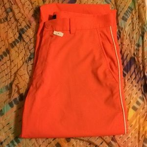 Men's Nike orange Golf pants, sz 34 M lightweight